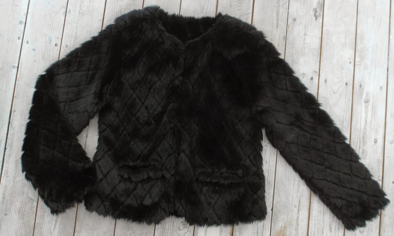 New in | Black fake fur