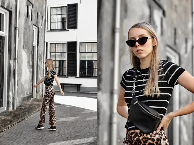 Outfit met Invito leopard broek Primark gestreepte crop top Aliexpress crossbody buiktas Nike Air Max 90 sneakers mode blog